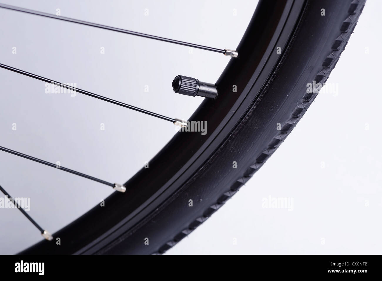 Bicycle tire and valve close up detail - Stock Image