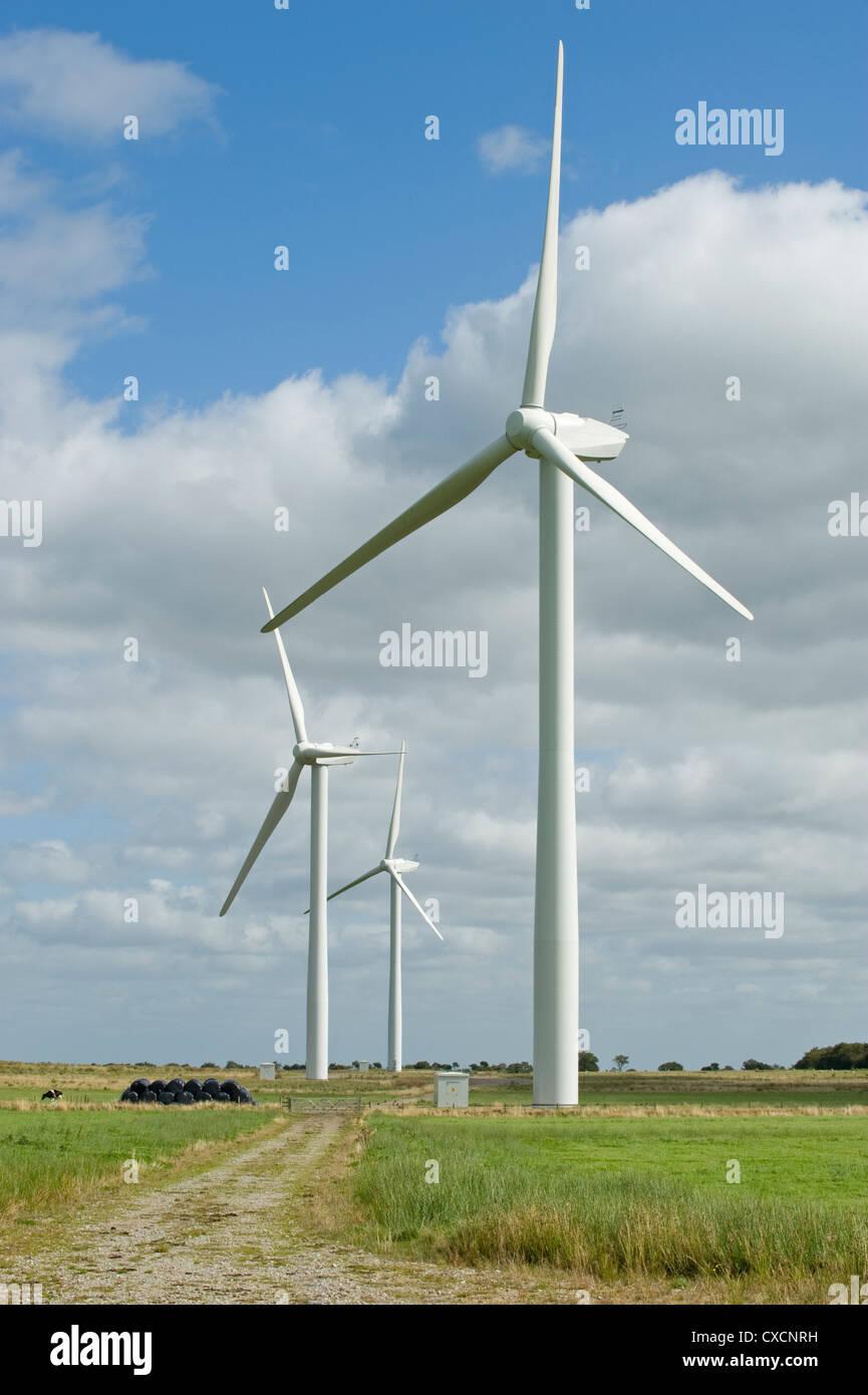 3 giant wind turbines (eyesore) tower over farmland fields in scenic countryside - Knabs Ridge onshore wind farm, Stock Photo