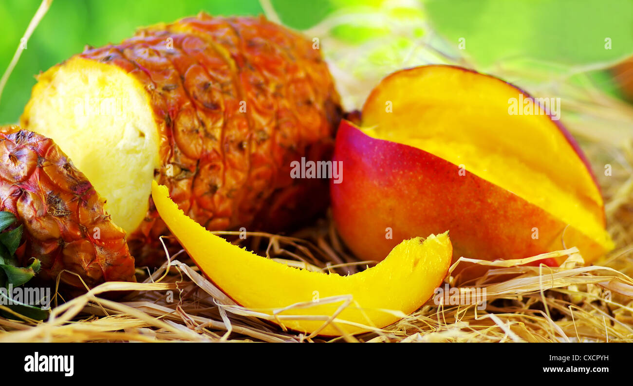 Pineapple and mango on table - Stock Image