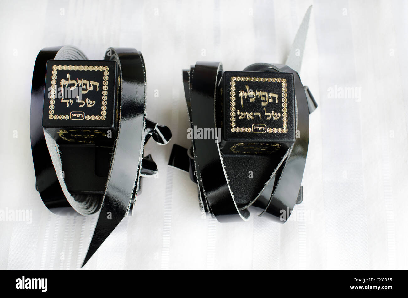 A set of tefillin includes the arm-tefillin (left) and the head-tefillin on Talit. - Stock Image