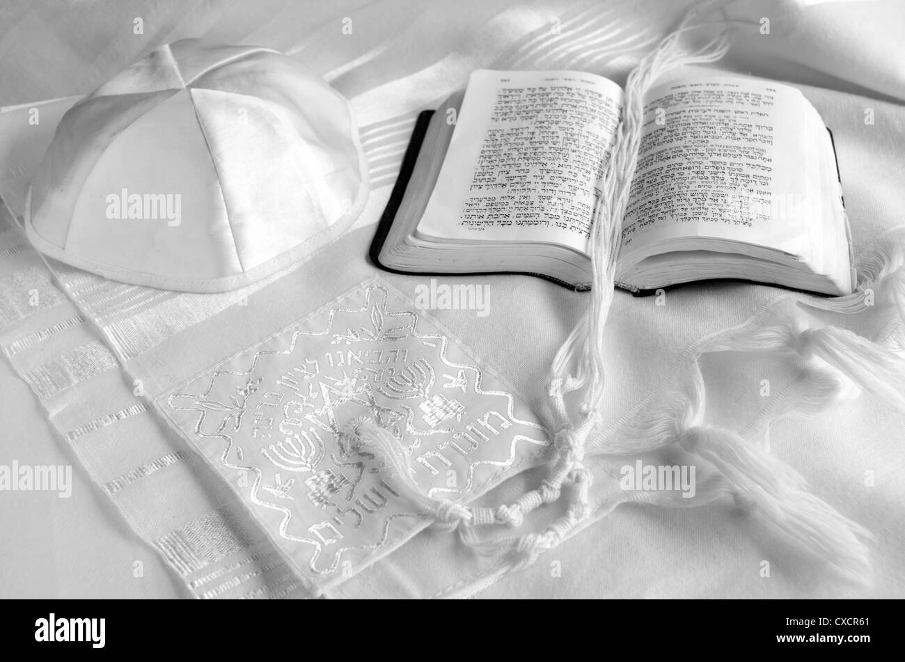 Tallit, yarmulke and praying book. - Stock Image