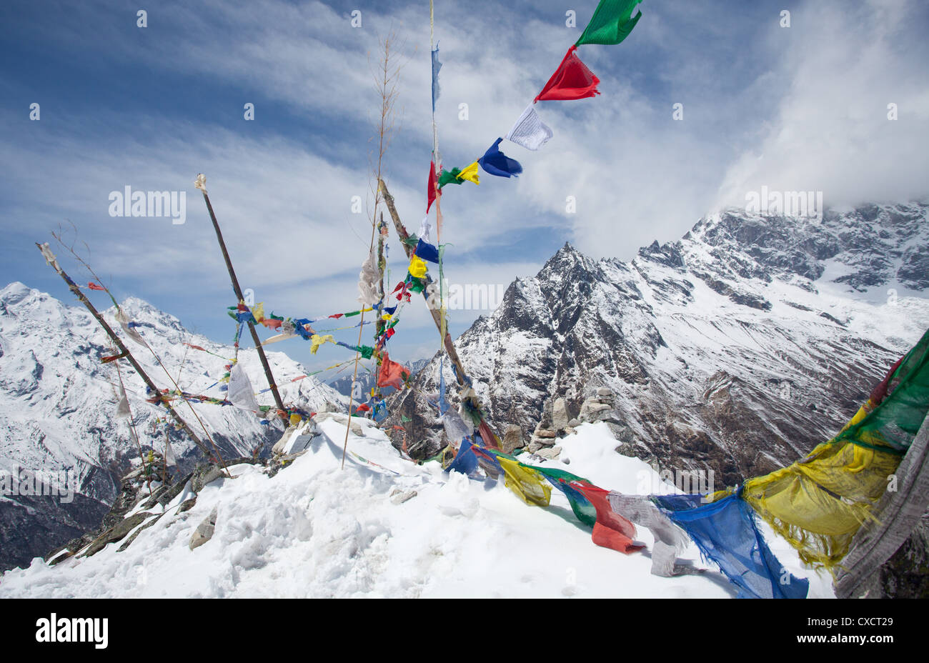 Prayerflags at the top of a mountain, Langtang Valley, Nepal - Stock Image