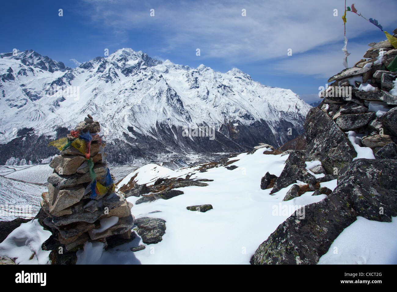Summit of Kyanjin Ri mountain with a Buddhist monument and prayerflags, Langtang Valley, Nepal - Stock Image