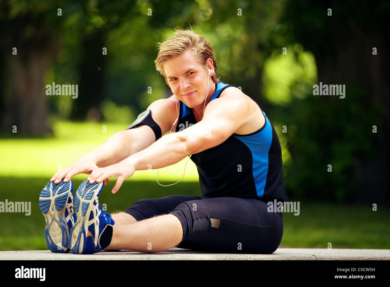 Active man doing his morning exercise at the park - Stock Image