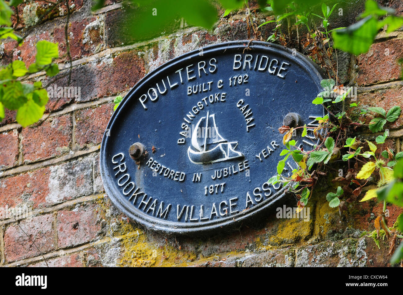 A sign for Poulters Bridge on the Basingstoke Canal UK - Stock Image