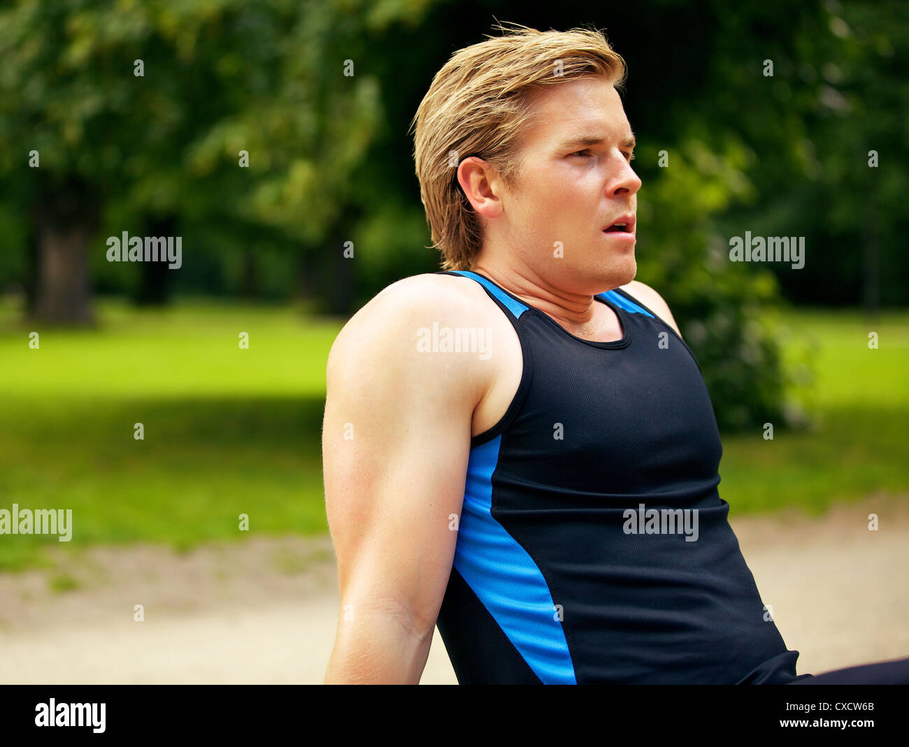 Athletic man resting after a tiring workout Stock Photo