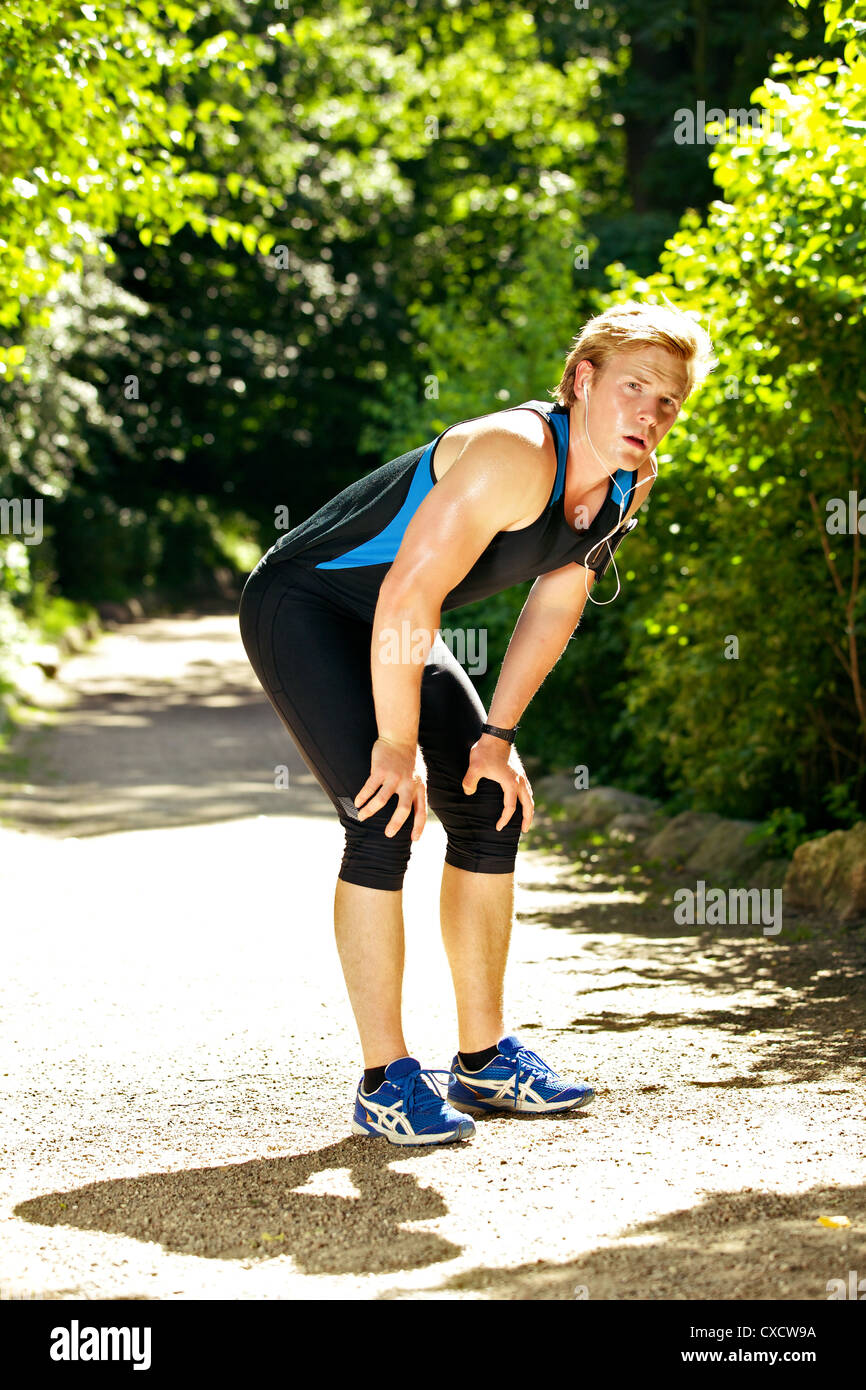 Tired athlete taking a break on a hot summer day - Stock Image