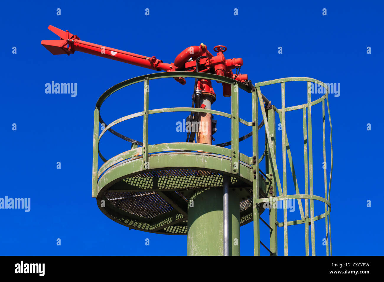 Fire Hose / Nozzle at an oil / gas heavy industry plant - Stock Image