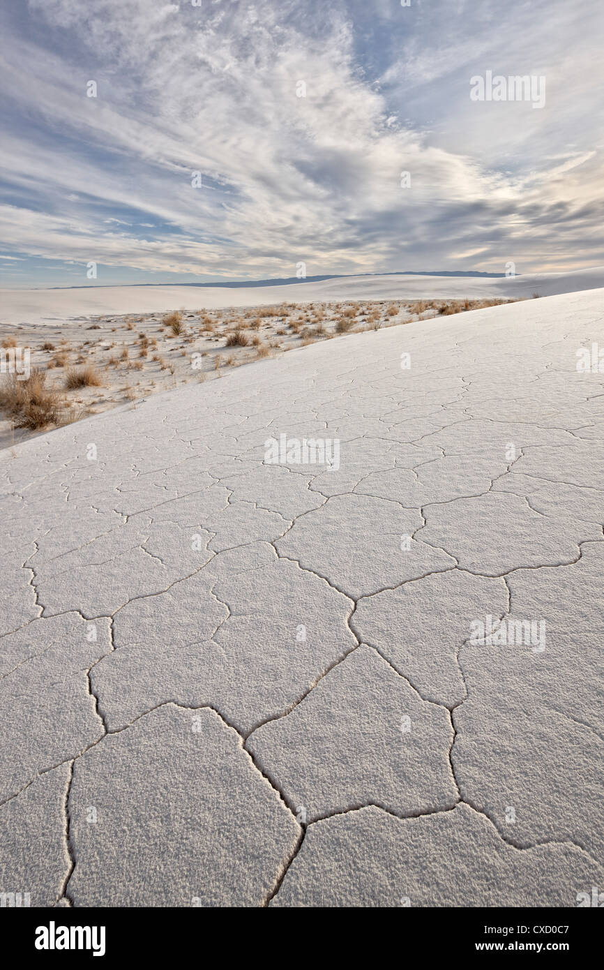 Cracked dunes with clouds, White Sands National Monument, New Mexico, United States of America, North America - Stock Image