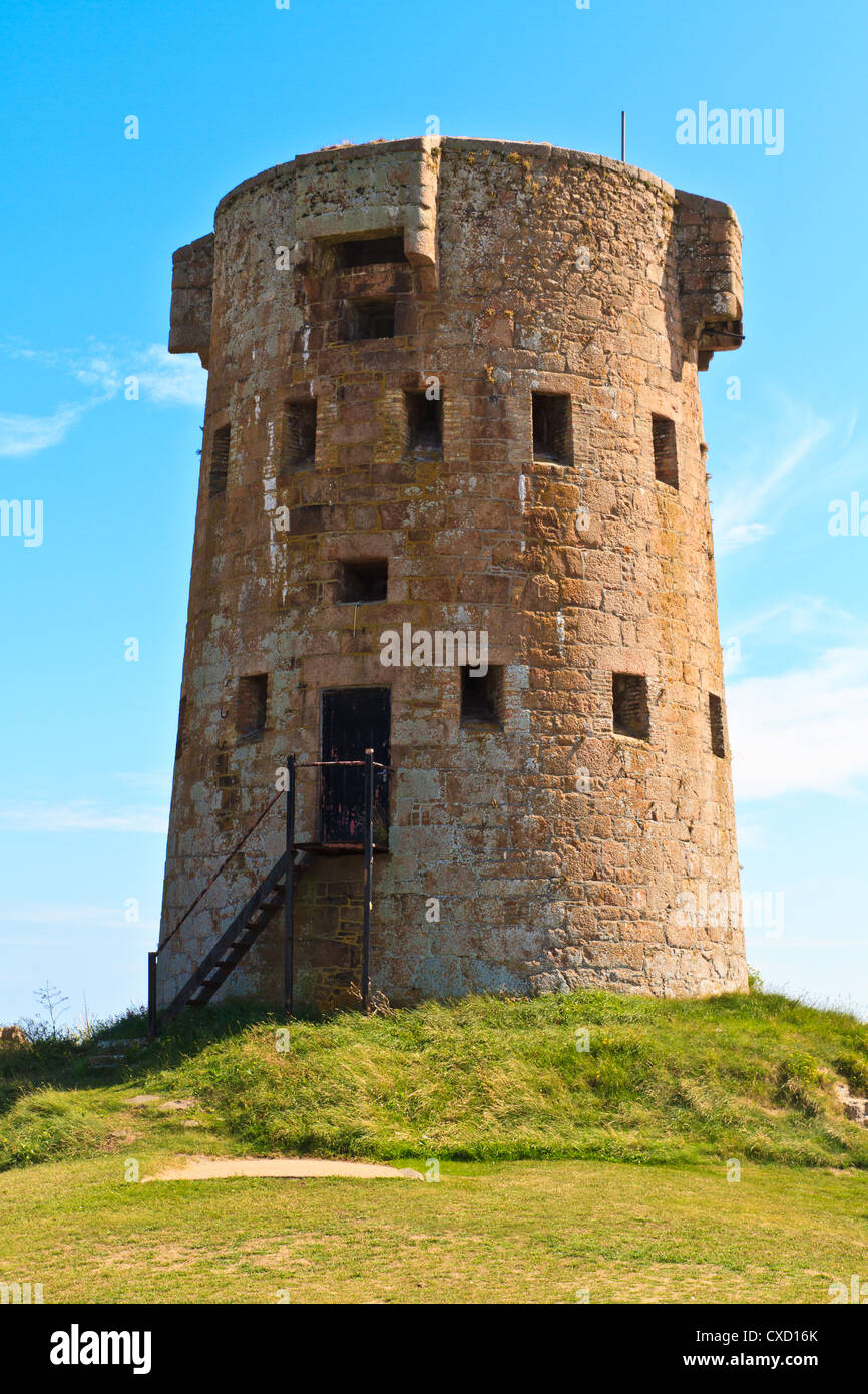 Coastal Tower of Jersey Island Fortifications at Le Hocq, Channel Islands, UK - Stock Image