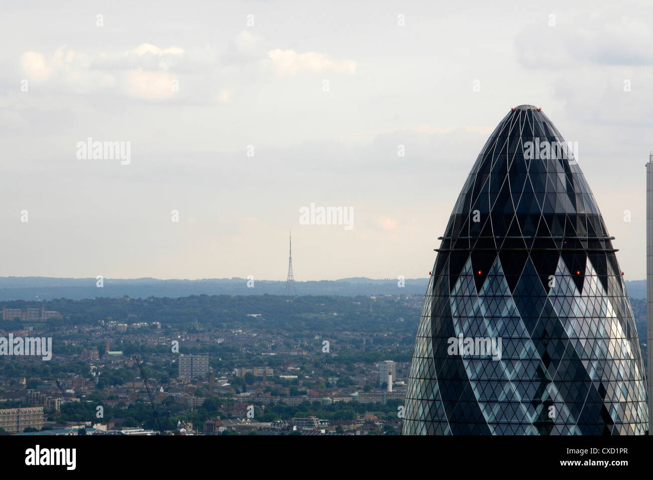Skyline view of the top of the Gherkin and all the way across south London to the Crystal Palace TV transmitter - Stock Image