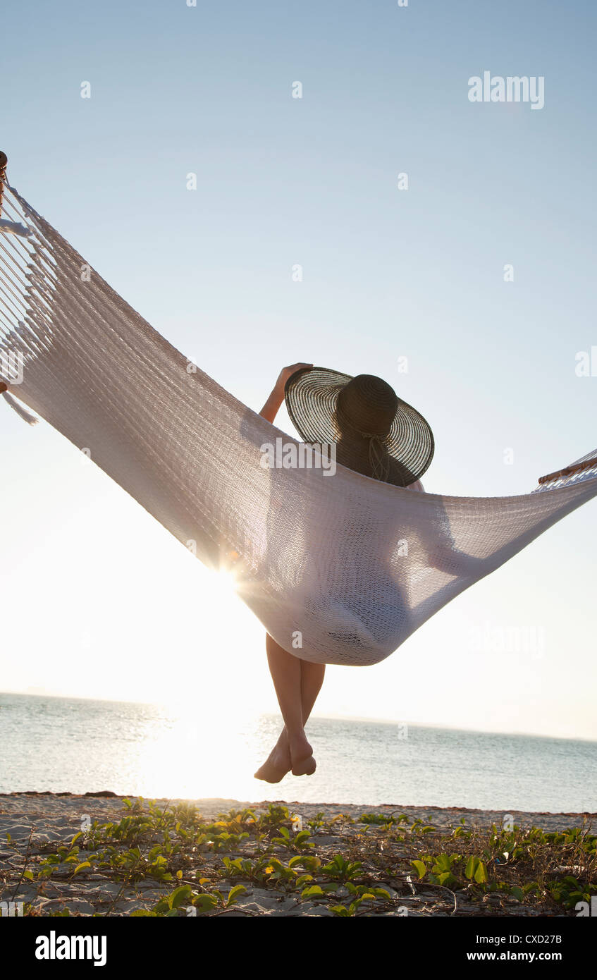 Woman on a hammock on the beach, Florida, United States of America, North America - Stock Image