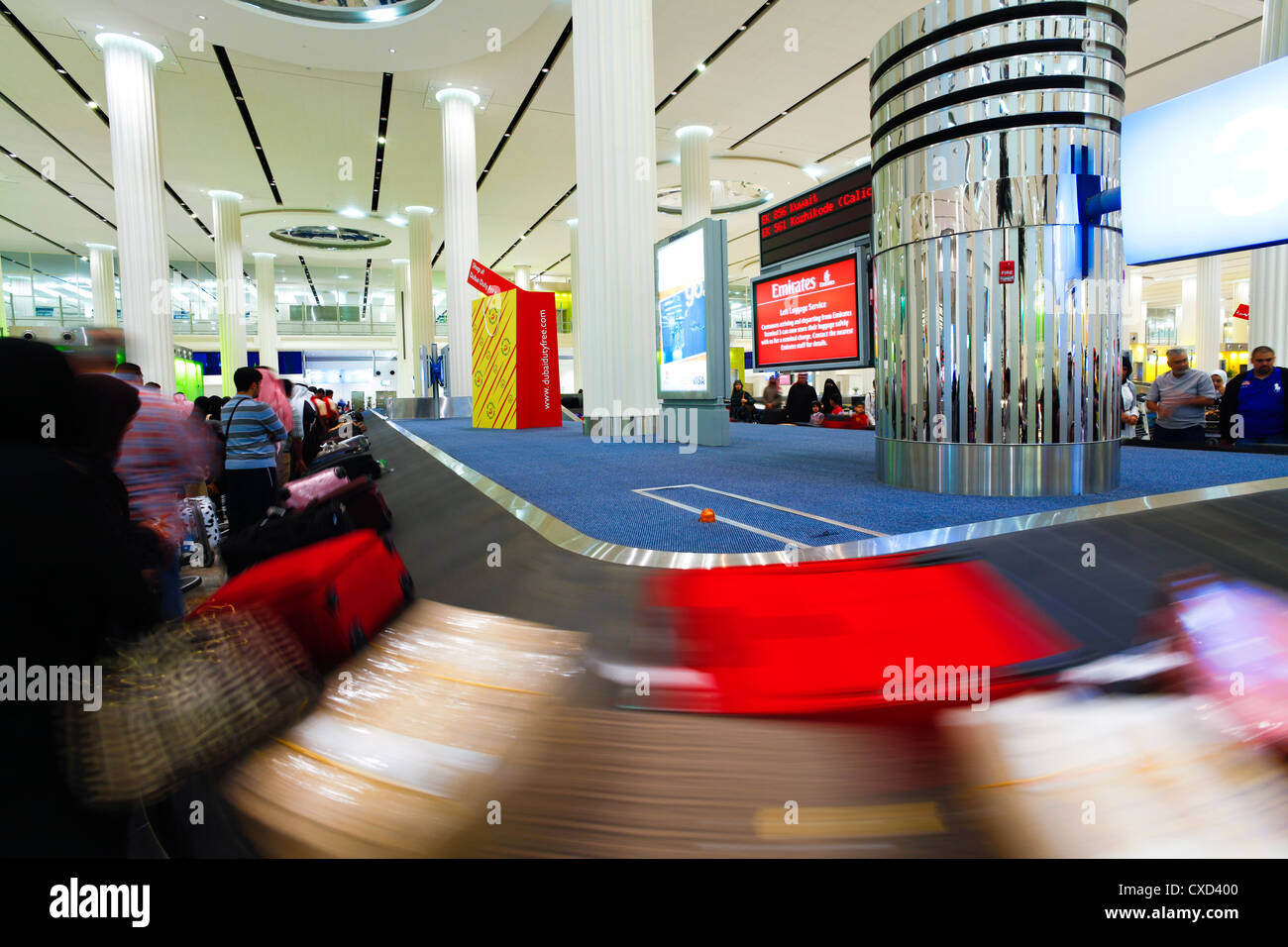 Baggage Carousel in the Arrivals Hall, Terminal 3, Dubai International Airport, Dubai, United Arab Emirates, Middle - Stock Image