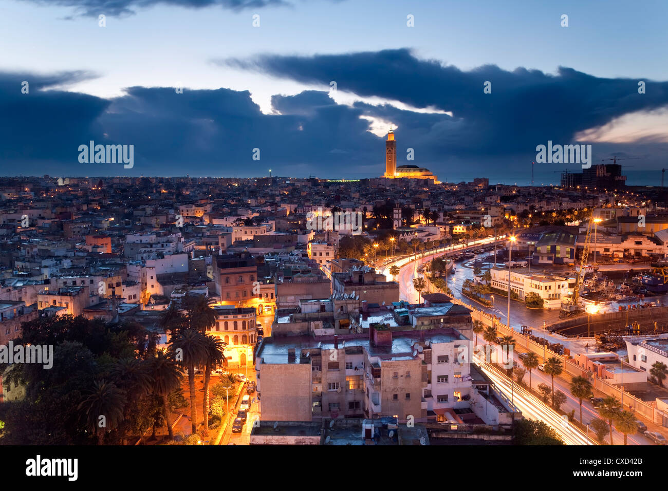 View over city with the Hassan II Mosque, the third largest mosque in the world in the bakcground, Casablanca, Morocco - Stock Image
