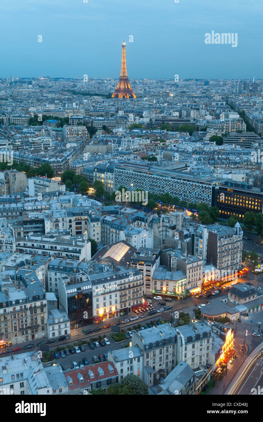 City and Eiffel Tower, viewed over rooftops, Paris, France, Europe - Stock Image