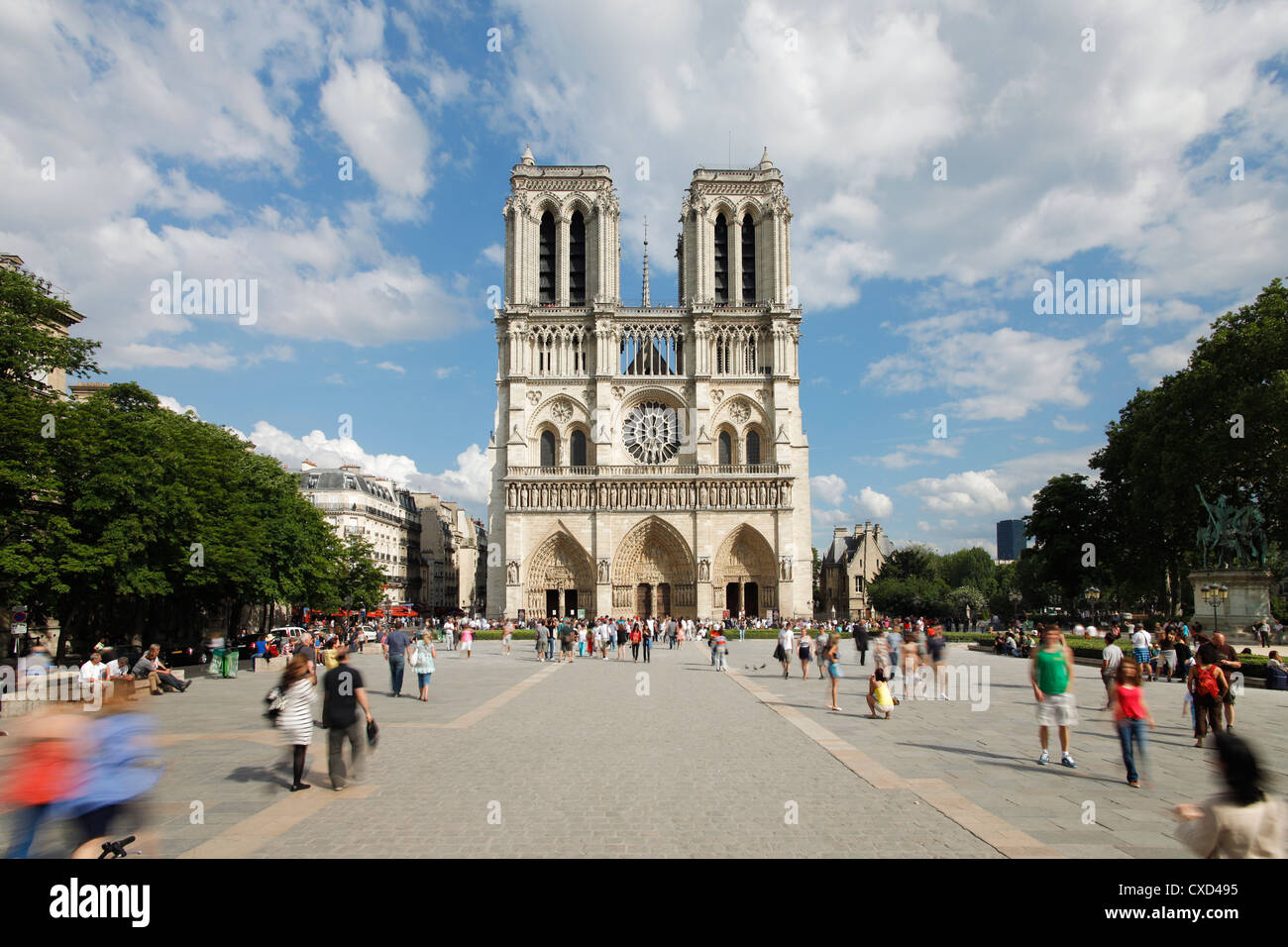 Tourists outside Notre Dame Cathedral, Paris, France, Europe - Stock Image