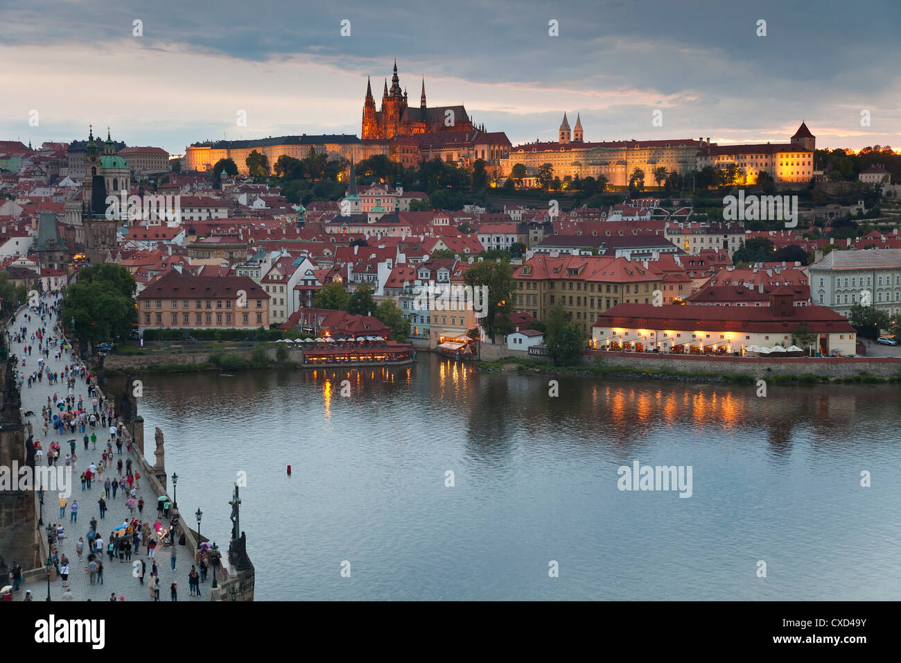 St. Vitus Cathedral, Charles Bridge, River Vltava and the Castle District illuminated at night, Prague, Czech Republic - Stock Image