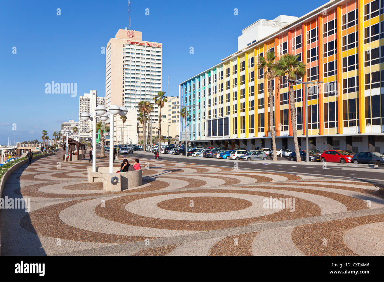 Beachfront promenade in front of the colourfully decorated hotel facades, Tel Aviv, Israel, Middle East - Stock Image