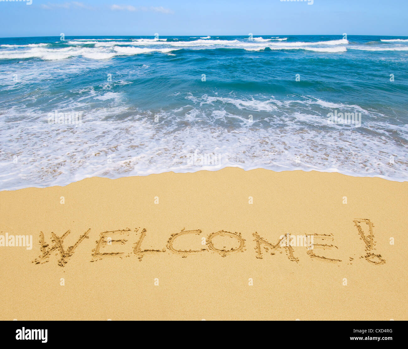 welcome written in a sandy beach - Stock Image