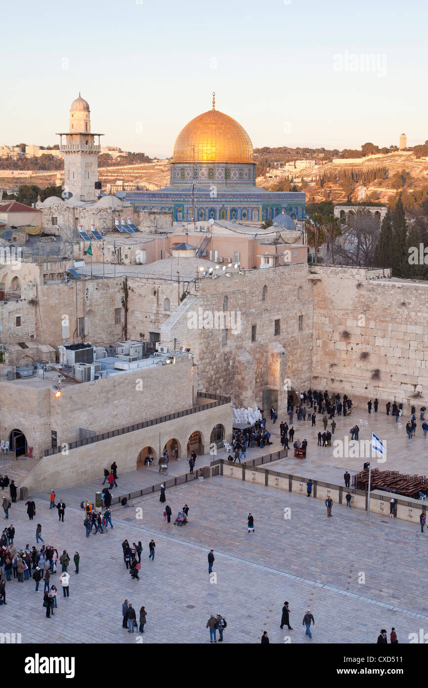 Jewish Quarter of the Western Wall Plaza with people praying at the Wailing Wall, Old City, Jerusalem, Israel - Stock Image