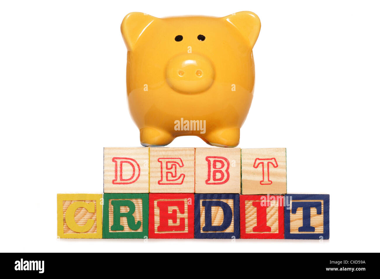 Piggy bank with debt and credit text studio cutout - Stock Image