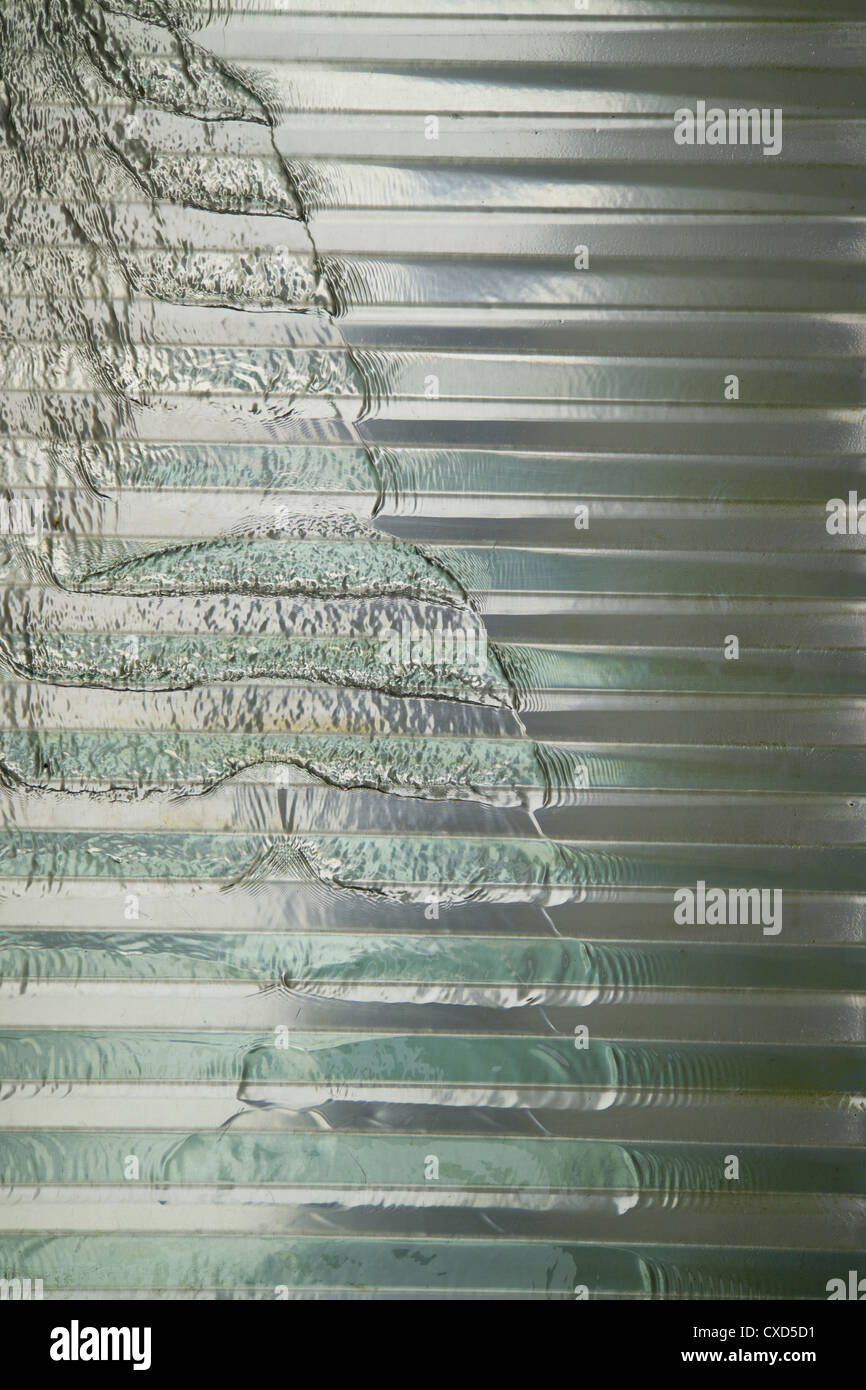Rippling water patterns over corrugated metal - Stock Image