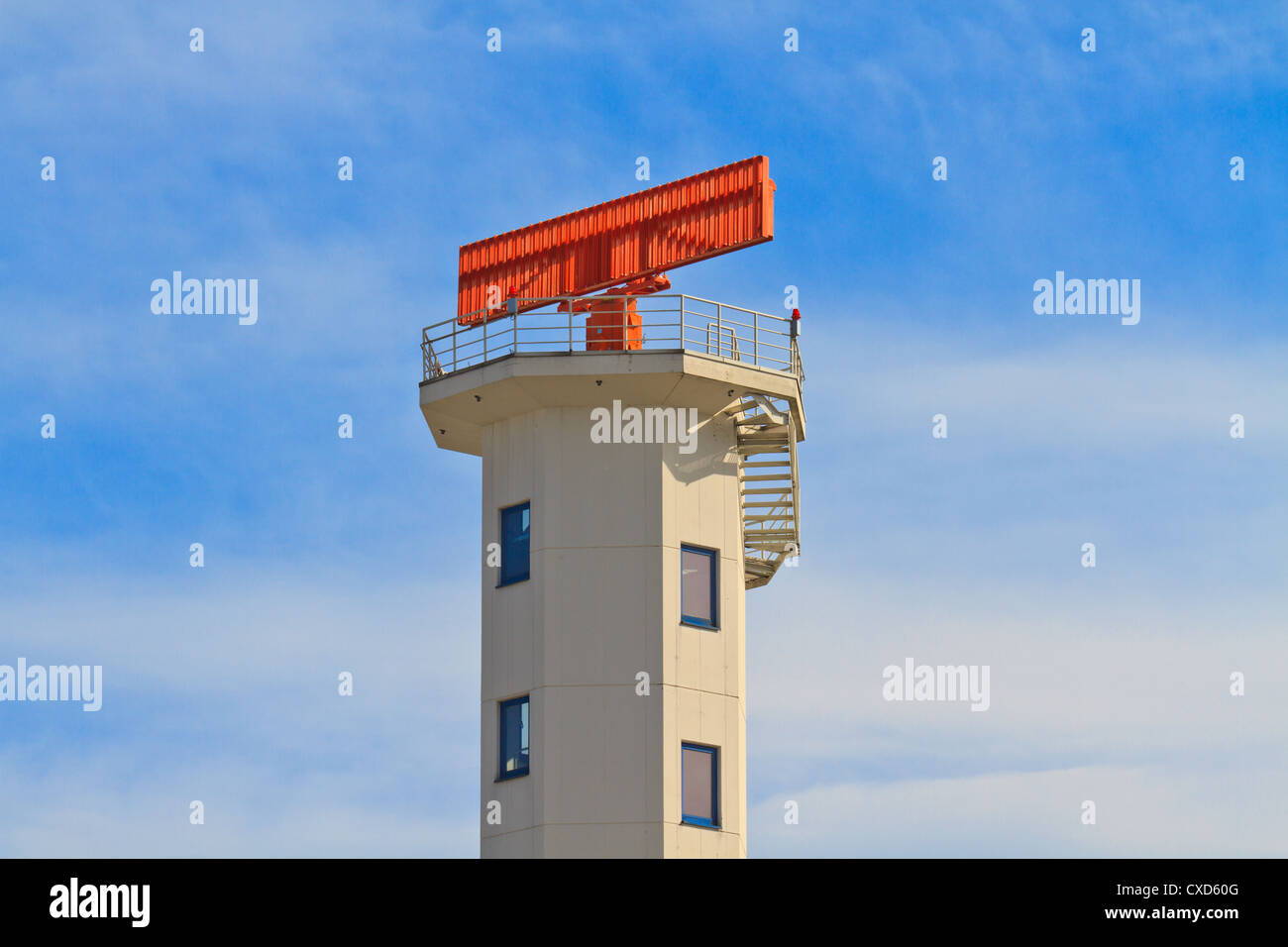 White Airport Tower with red radar on top - Stock Image