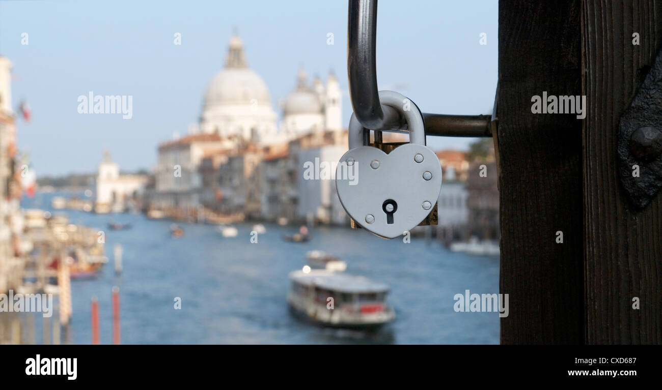 heart shaped love locks lovers padlock attached to the Ponte dell'Accademia bridge over the Grand Canal Venice - Stock Image