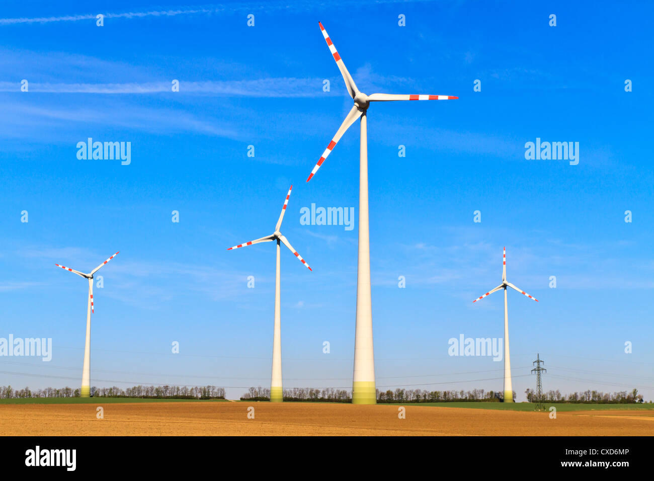 Meadow with Wind turbines generating electricity - Stock Image