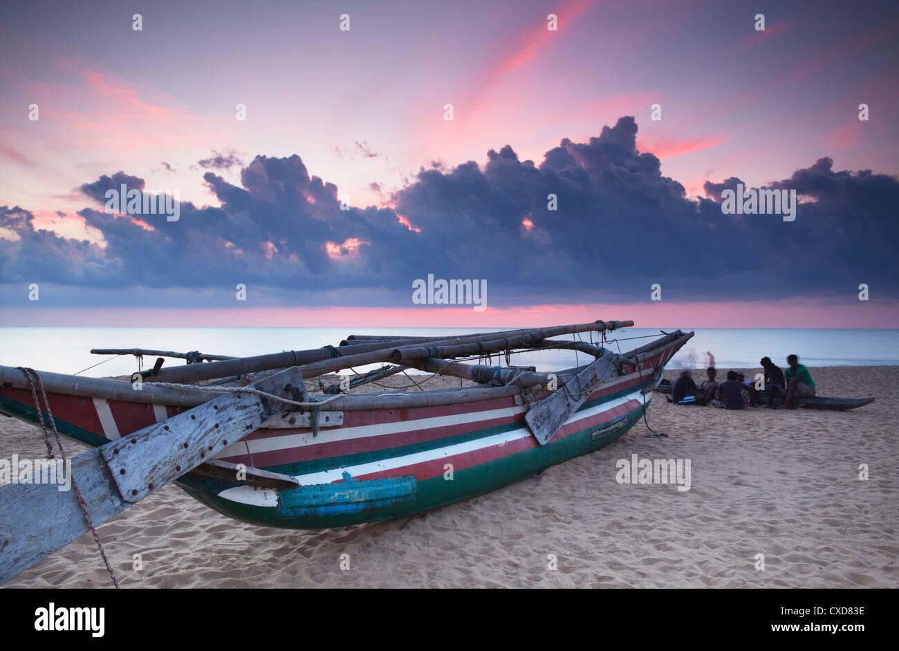 Oruwa (outrigger canoe) on beach at sunset, Negombo, North Western Province, Sri Lanka, Asia Stock Photo