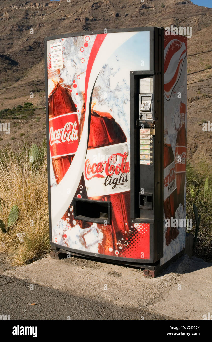coke machine vending machines coin operated diet marketing cold cans can refrigerated - Stock Image