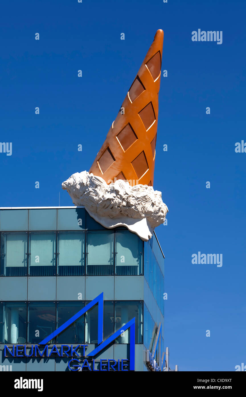 Dropped Cone, by the pop-art artist Claes Oldenburg, ice cone sculpture, roof of the Neumarkt Galerie, Cologne,Germany, - Stock Image