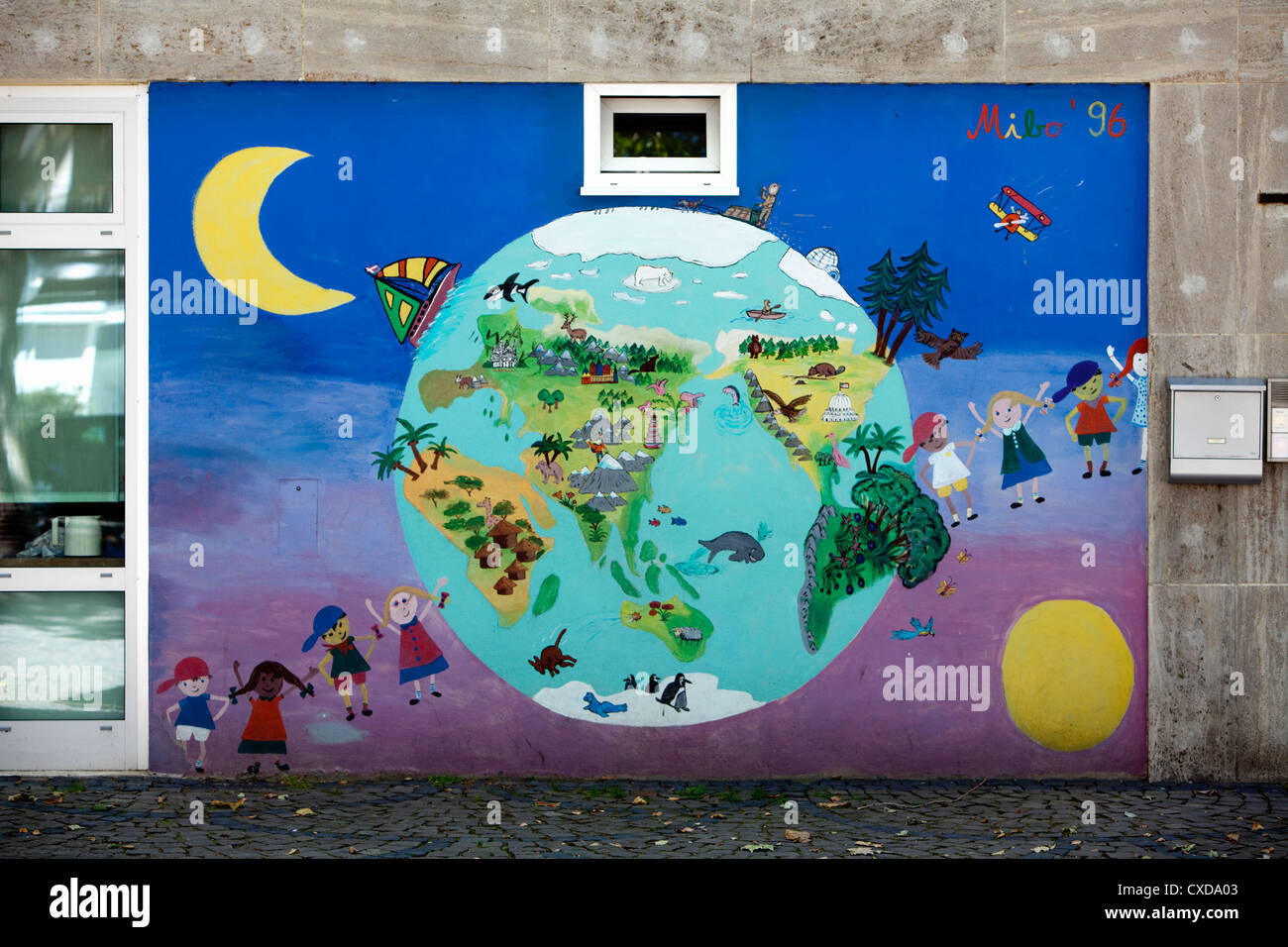 Children and a globe, painted by children, drawing, Graffiti - Stock Image