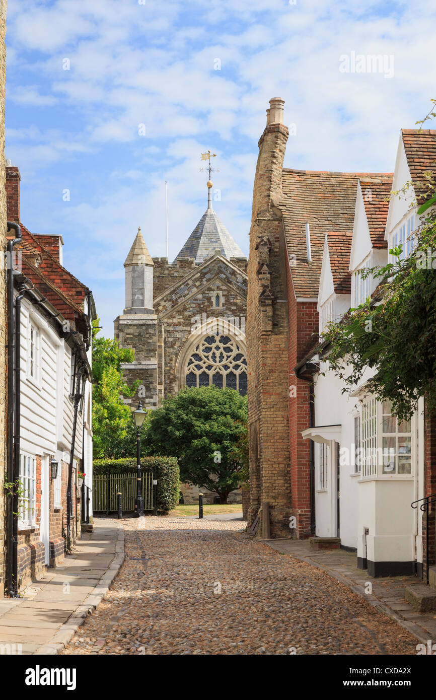 View along narrow cobbled street to St Mary's parish church in the historic town of Rye, East Sussex, England, - Stock Image