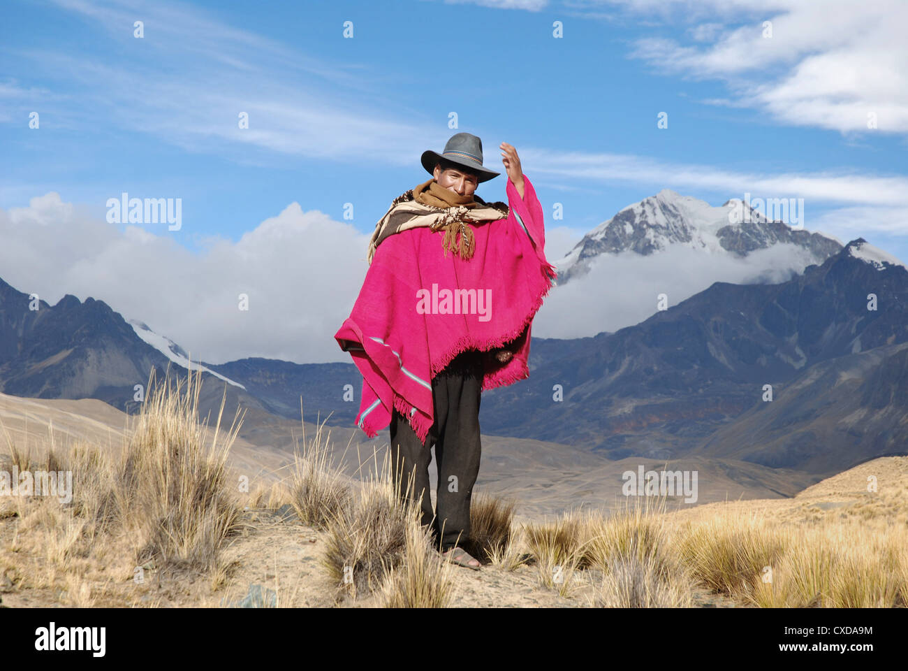 Aymara Headman in the Cordillera Real with the mountain Huayna Potosi in the background Stock Photo