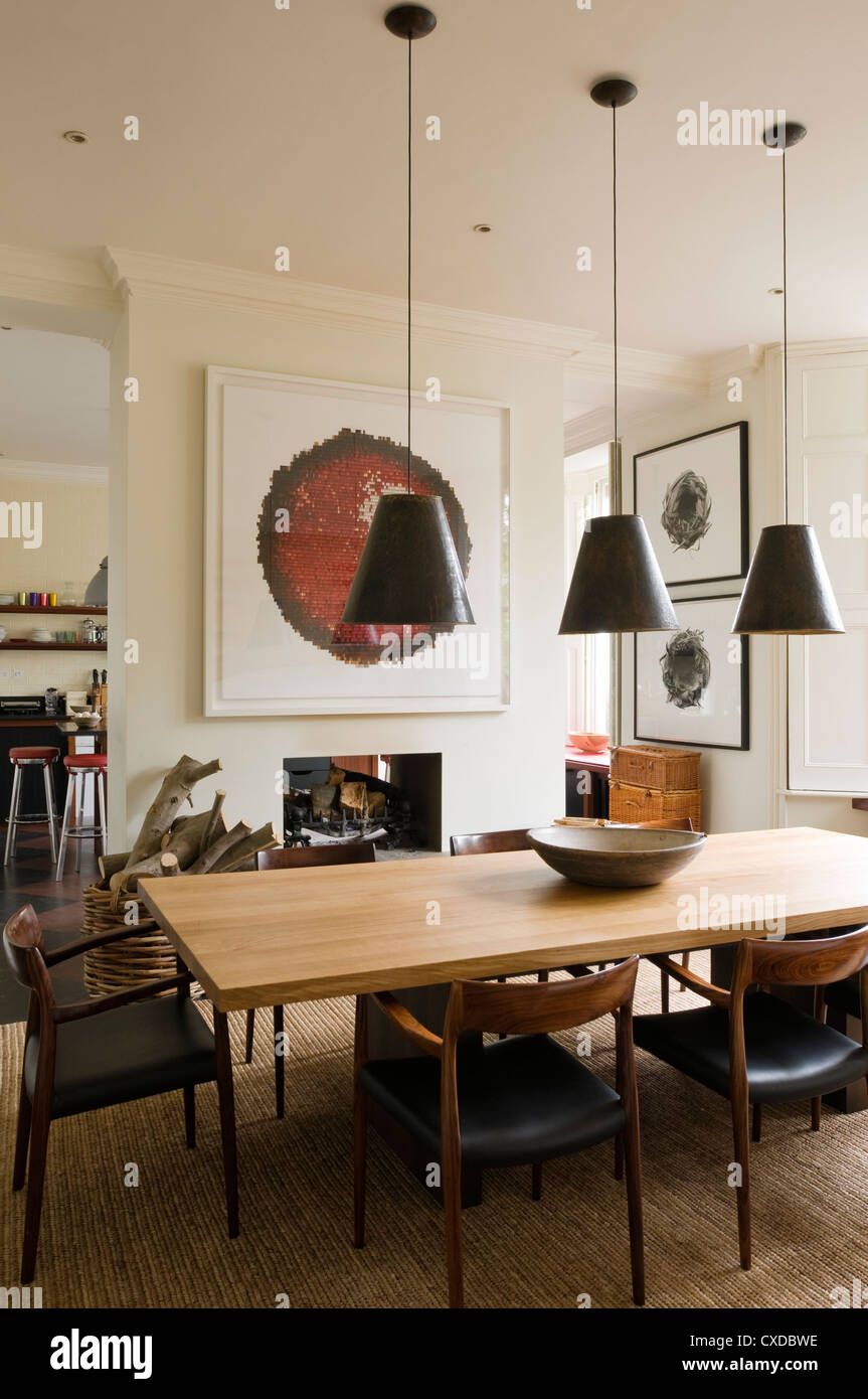Dining Room With Three Pendant Light Shades Stock Photo Alamy