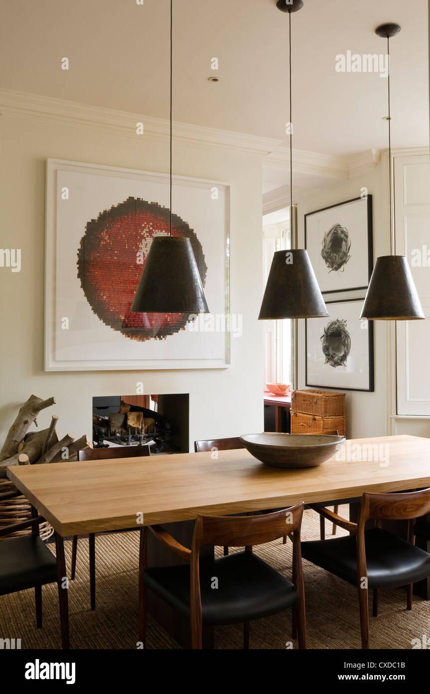 Dining Room With Three Pendant Light Shades