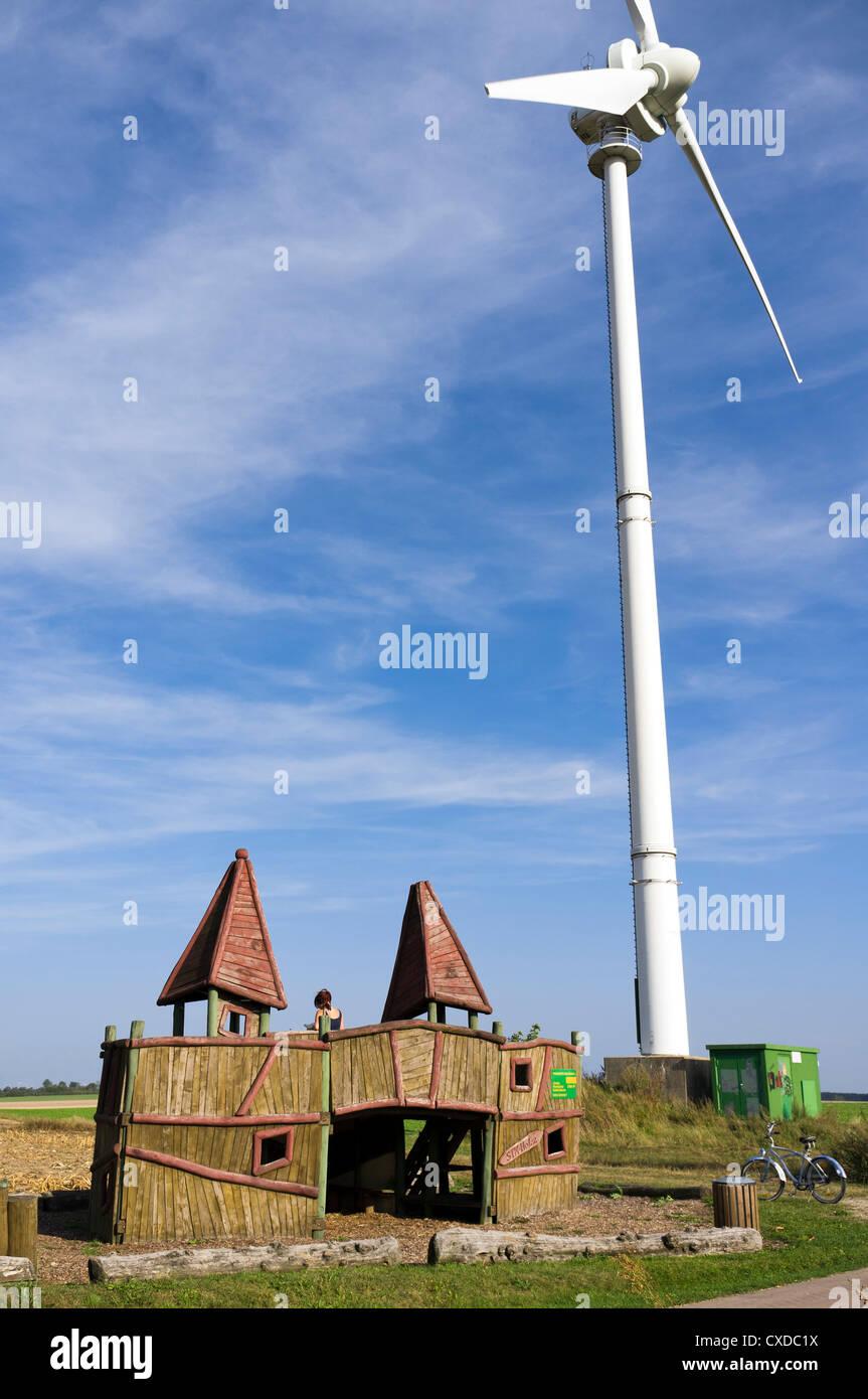 Resting place in front of wind turbine near Jüterbog, Brandenburg, Germany - Stock Image