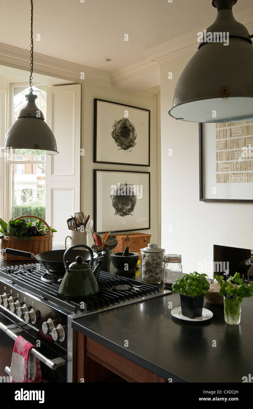 Kettle On Hob Of Kitchen Island With 1950s Grey Pendant Lights And Stock Photo Alamy