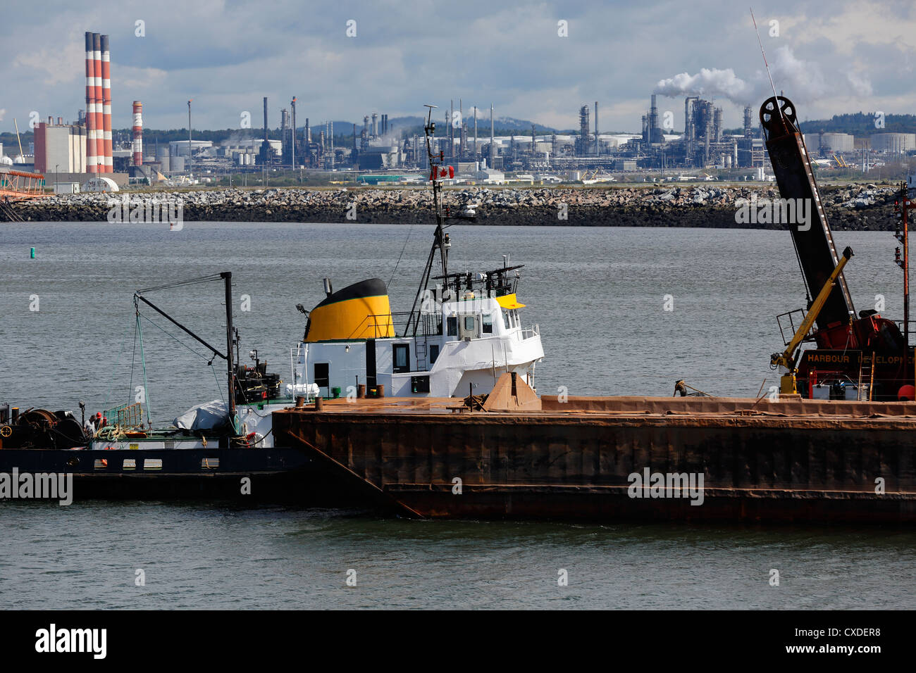 dredging operation and oil refinery in Saint John, New Brunswick - Stock Image