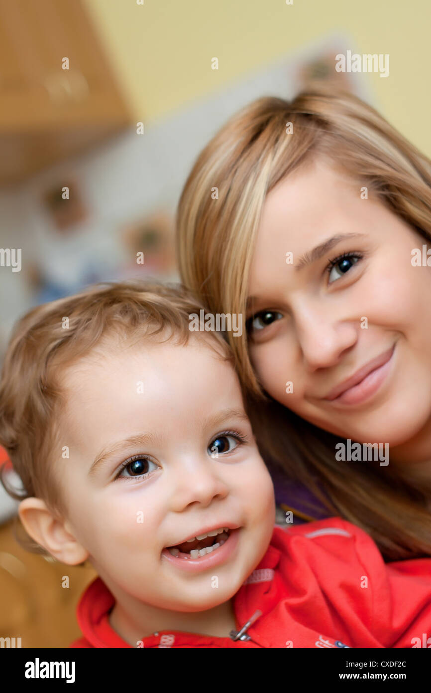 Portrait of two smiling kids - soft focus - Stock Image