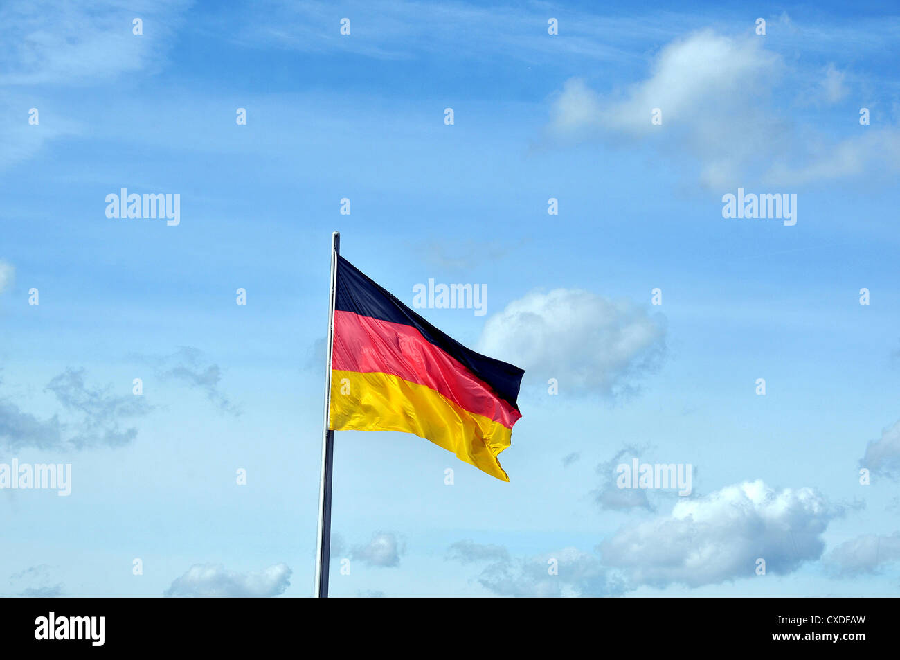 German flag in blue sky Berlin Germany - Stock Image