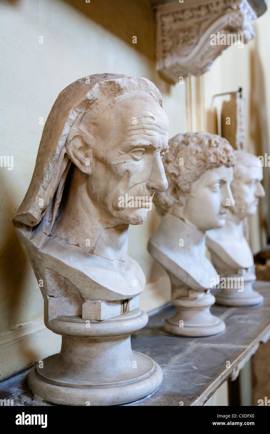Ancient marble Roman busts on a shelf, Vatican Museum, Rome, Italy. - Stock Image