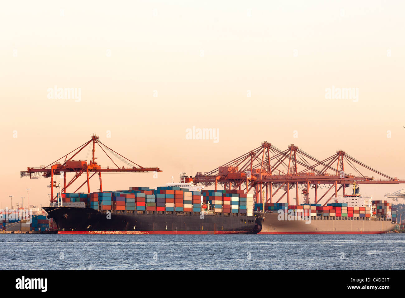 Cargo ships with containers at port - Stock Image