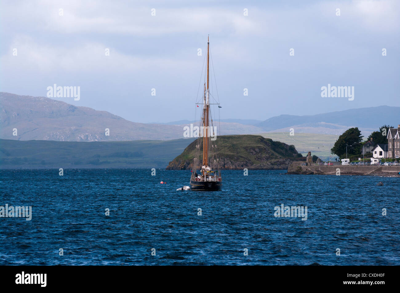 Twin Masted Yacht Moored In Oban Bay Oban Argyll and Bute Scotland Stock Photo
