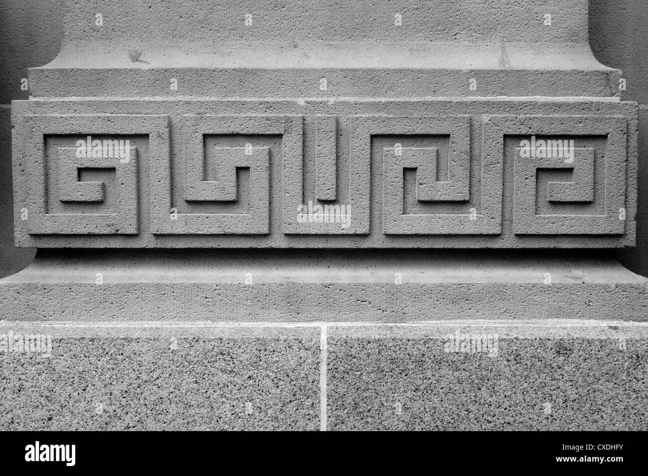 Symmetrical geometric design on the facade of a stone building in Vancouver, BC, Canada - Stock Image