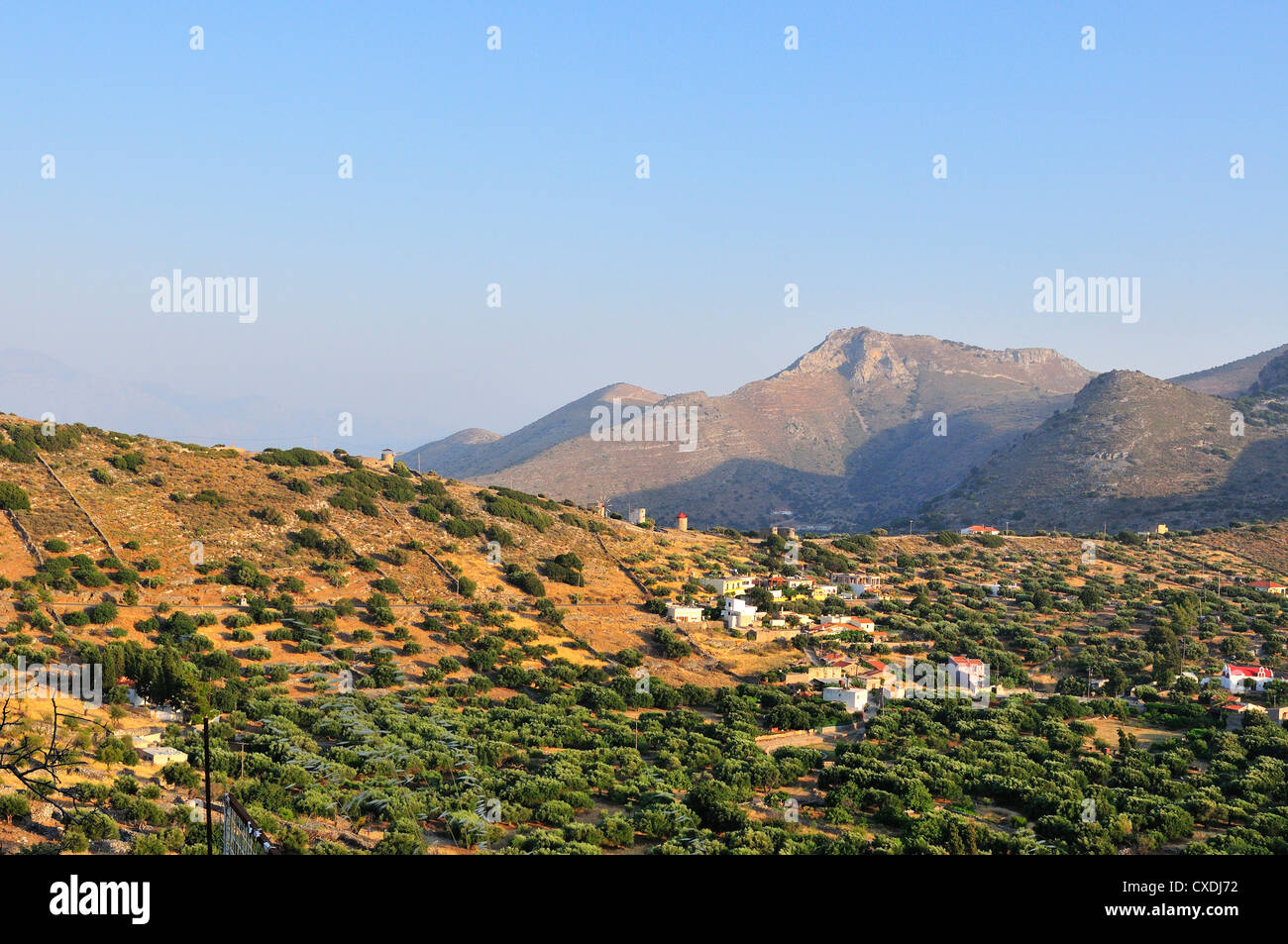 hill top village Pano Pine above old  Elounda with disused windmills on the ridge crest of kato pine - Stock Image