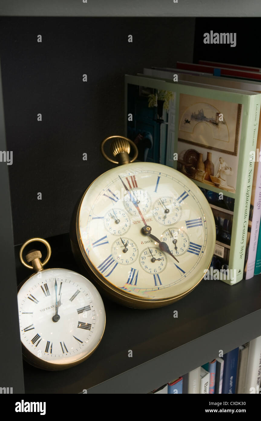Two large ball clocks with roman numerals on clock face - Stock Image