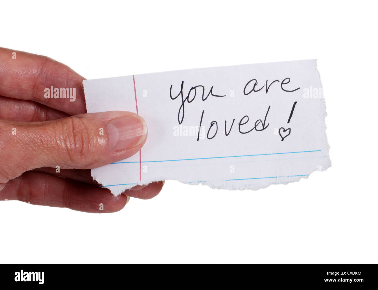 Close up of a hand holding a note with the words: 'You Are Loved'. Isolated on white. - Stock Image