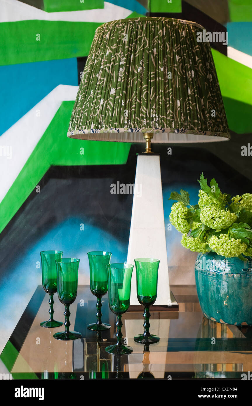Antique objects set against bold 21st century graffiti wall decoration - Stock Image